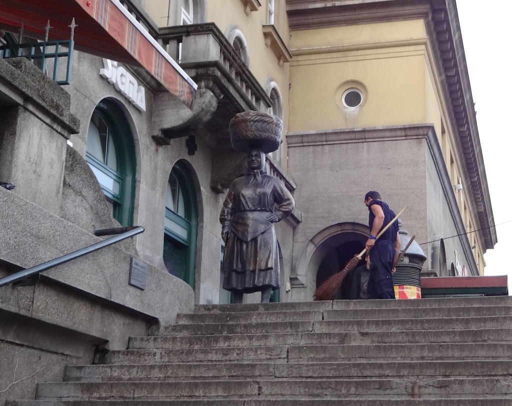 The statue of a traditional Dolac Market saleswoman, celebrating the local tradition of carrying produce on one's head without losing balance and tripping down the market steps