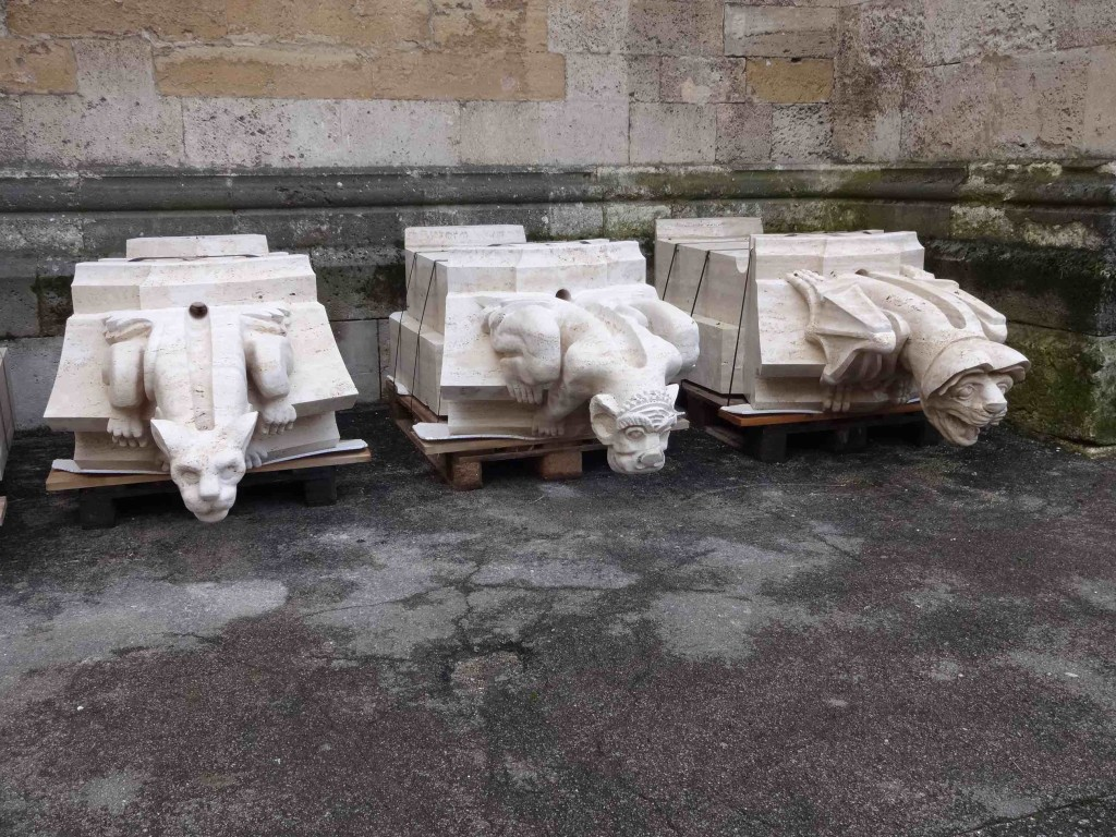 Newly masoned gargoyles waiting to be hoisted up onto the roof of the cathedral to replace ones badly eroded by weather and pollution