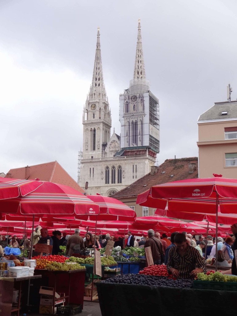 Dolac Market, the city's historic and most popular marketplace just a stone's throw away from Trg ban Josip Jelačić, with the Cathedral of the Assumption of the Virgin Mary seen in the background. Every day since the 1930s, locally produced food products and ornaments have been sold here