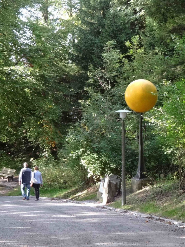 Zurich Uetliberg, Planetenweg, Planet trail, Sun, couple walking past it