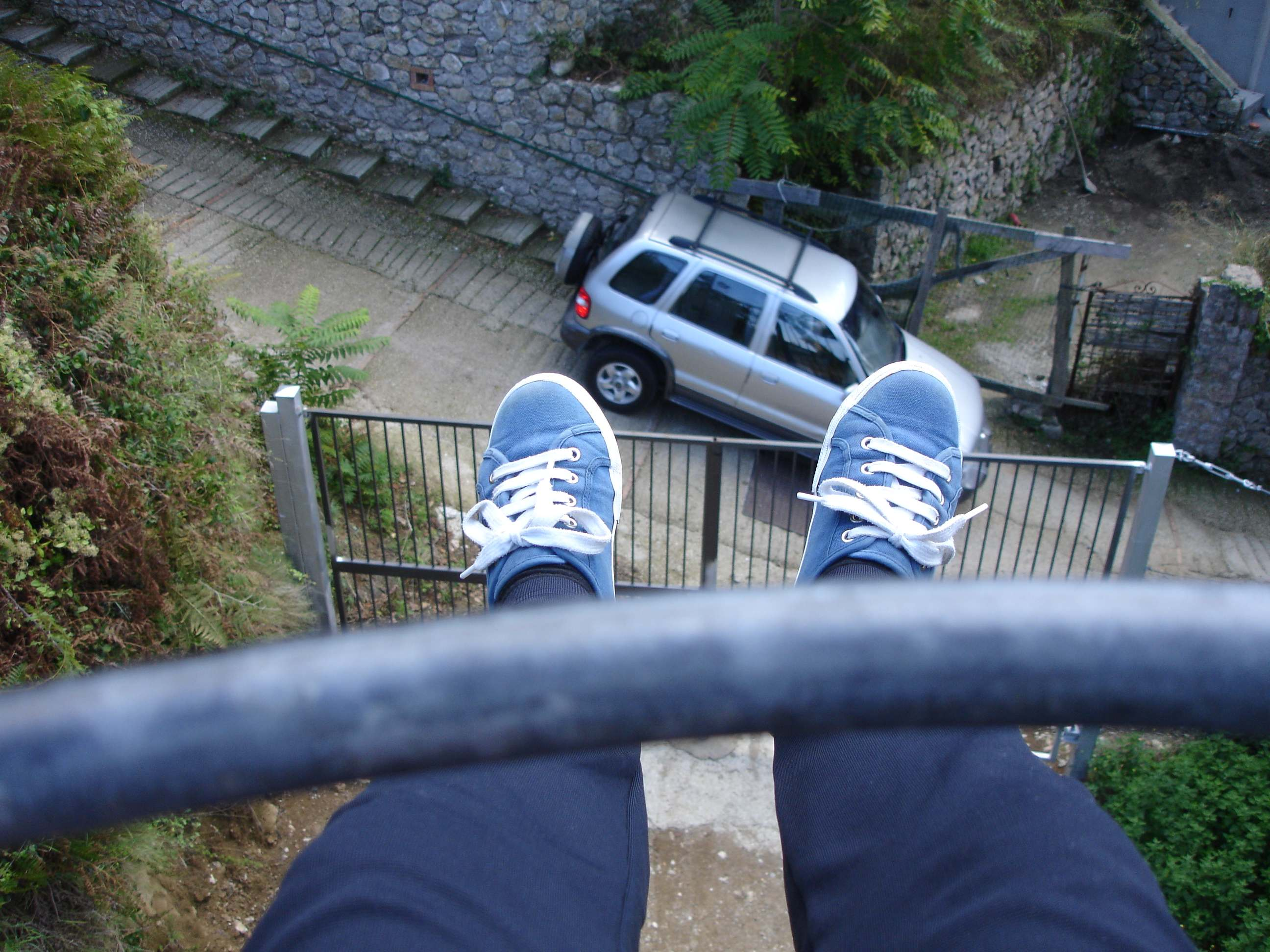 capri anacapri daggling over a road on the chairlift the lady travels